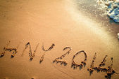 Writing Happy New Year's 2014 on the Beach in Thailand — Stock Photo