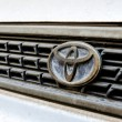 Logo of Toyota old Corolla on display.Toyota Group is best known — Stock Photo