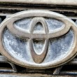 Постер, плакат: Logo of Toyota old Corolla on display Toyota Group is best known