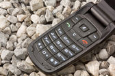 Mobile Phone on the Gravel — Stock Photo