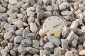 Old Watch Emerging from the Gravel — Stock Photo