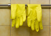 Rubber Gloves Against Kitchen's Wall — Stock Photo