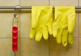 Rubber Gloves and Red Handled Tool — Stock Photo