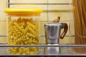 Jars of Pasta and Mini-Coffee Maker — Stock Photo