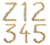 Letters and Numbers Made of Peanuts — Stock Photo