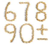 Cijfers en symbolen gemaakt van pinda 's — Stockfoto