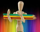 Manequim de madeira com lápis de cor — Fotografia Stock