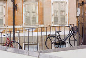Two Bicycles Parked Along a Railing — Stock Photo