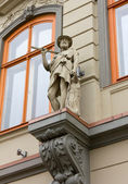 Mythological Statue On the Facade of a Palace — Stock Photo