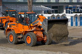 Bulldozers at Work on a Beach — Stock Photo