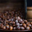 Hazelnuts in Wooden Box and Brass Plate — Stock Photo #11945455