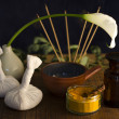An arrangement of , spice, oil and massaging tools used in Ayurvedic medicine — Stock Photo
