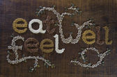 The Phrase Eat Well, Be Well Written And Decorated In Seeds — Stock Photo