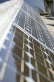 Closeup of some solar panels reflecting surroundings — Stock Photo