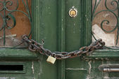 Green Door with Chain and Padlock — Stock Photo