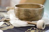 A tibetan singing bowl with baton — Stock Photo