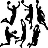 Basketball players silhouettes in action — Stock Vector