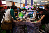 Visitors Playing Video Games at Indo Game Show 2013 — Stock Photo