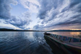 Storm clouds with a boat on the lake — Stock Photo