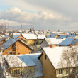 View over houses under snow - Stock Photo