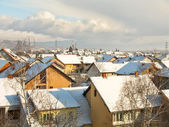 View over houses under snow — Stock Photo
