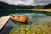 Boats in lake the mountains landscape — Stock Photo