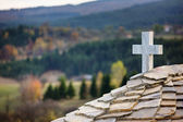 Cross on a church in the mountains — Stock Photo