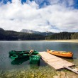 Canoes on beautiful mountain lake — Stock Photo