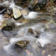 Cascade falls over mossy rocks — Stock Photo #18808699