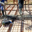 Floor above joists in precast prestressed concrete  Concrete casting to completion until the realization of a screed of appropriate thickness — Stock Photo