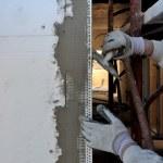 Construction site - Installing external insulation. — Stock Photo #17443579