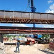 Bridge construction corten steel cranes - Stock Photo