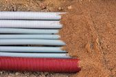 Beam corrugated conduits underground — Stock Photo