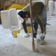 Stock Photo: Ricklayer sets construction of partition wall with aerated concrete blocks