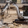 Excavator with hammer engaged in excavation of foundation — Stock Photo #34245493