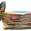 Stock Photo: 45 rpm vinyl discs stack on white background