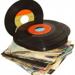 Stock Photo: Pile of 45 RPM vinyl records used and dirty even if in good condition