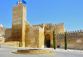 Seville gate alcazar with a fountain in the foreground — Stock Photo