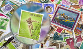 Old stamps under magnification lens — Stock Photo