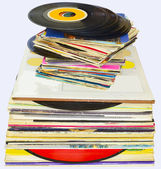 33 and 45 rpm vinyl discs stack on white background — Stock Photo