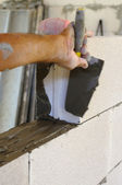 Mason performs an internal masonry blocks aerated concrete — Stock Photo