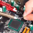 Stock Photo: Repair of electronic components