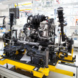 Stock Photo: Car engine assembled standing on factory production line