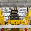 Stock Photo: Car on production line under construction