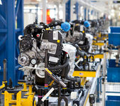 Car engine assembled on the factory production line — Stock Photo