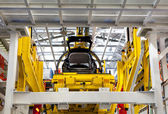 Car on the production line under construction — Stock Photo