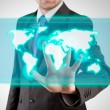 Stock Photo: Businessminteracting with virtual display world map