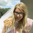 Funny bride with lollipop — Stock Photo