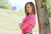 Young woman near tree — Stock Photo