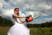 Crazy bride in field — Stock Photo